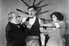 1920:  A lucky escape after some knife throwing antics during an unknown film.  (Photo by Hulton Archive/Getty Images)
